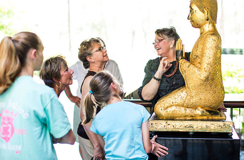 docent speaking about buddha statue