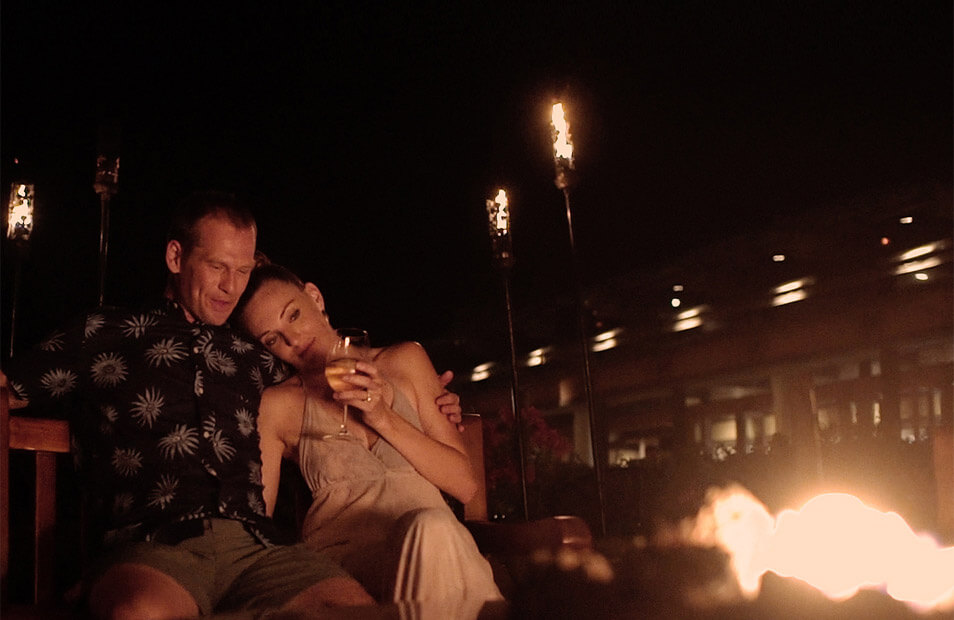 couple relaxing in front of fire
